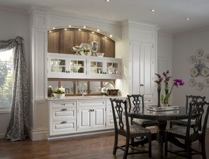wooden butler pantry with plates in it